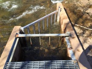 New deflector installed at the top of the fish ladder last fall